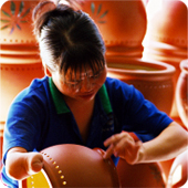 """A hard Living, Day Work"" - Vietnamese woman who is missing part of her right hand earns a living making ceramic products in Binhduong province, Viet Nam."
